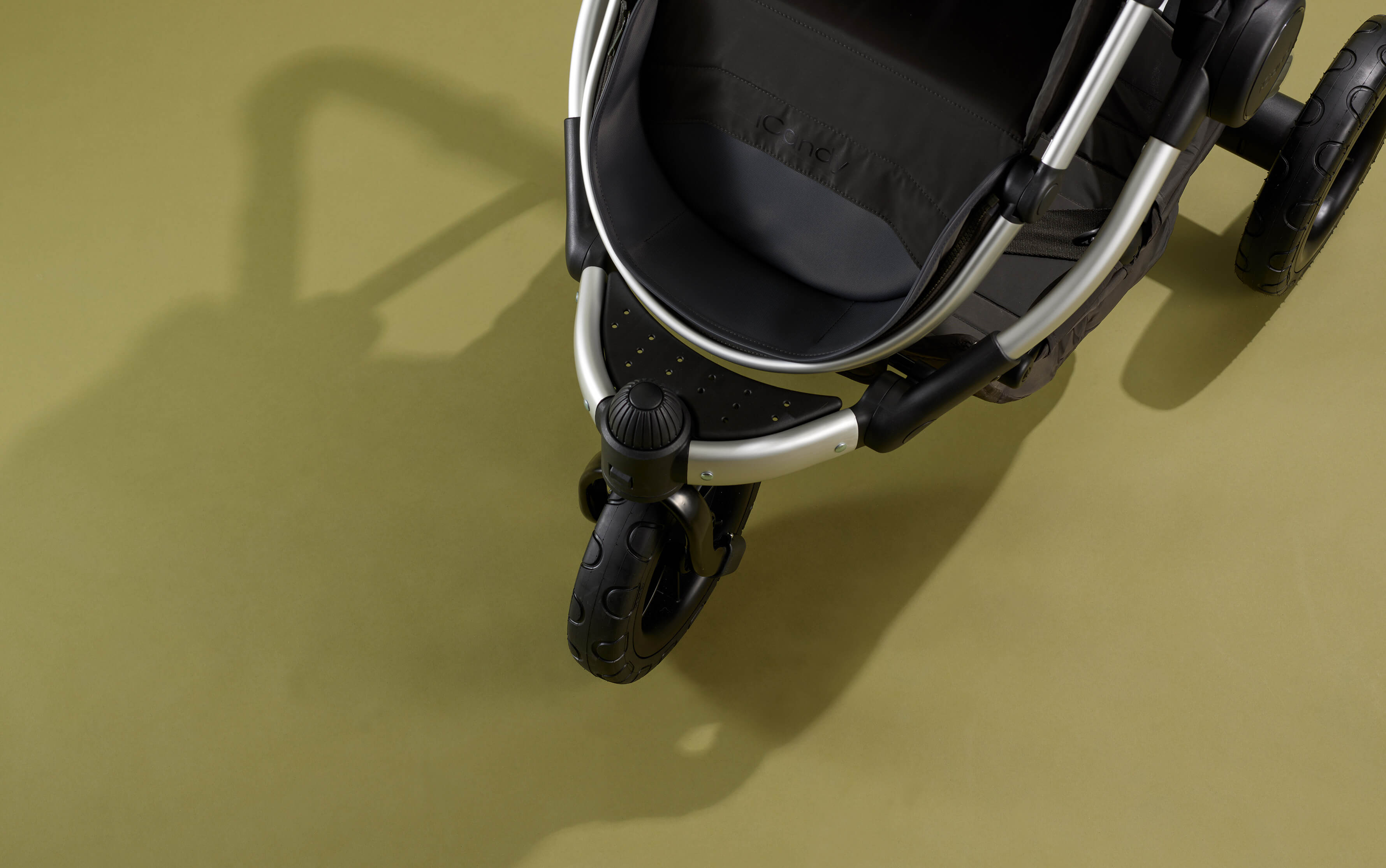 What is a three-wheel pushchair?
